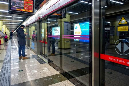 BEIJING, CHINA - MARCH 12, 2016: Beijing metro station. According to the plan, by 2020, the Beijing subway will form a line network of 30 lines and a total length of 1177 kilometers.