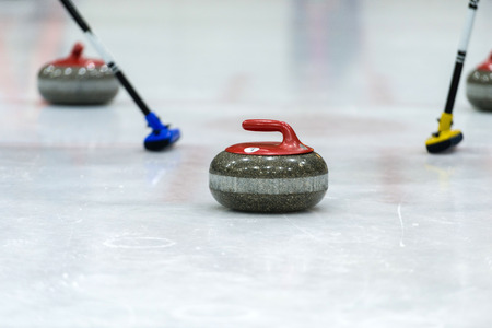 Close up of a Curling game situation.