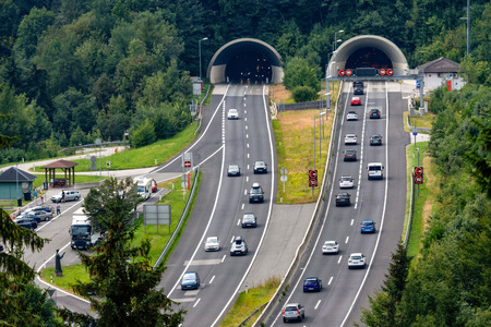 Beautiful view of mountains and entrance to autobahn tunnel near village of Werfen, Austria Stock Photo
