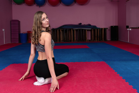 Young fitness athlete performs exercises in the gym. Body-building. - Image