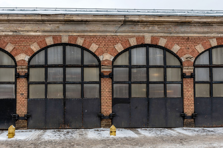 Riga. Latvia. Old fire depot building with metal gate row.