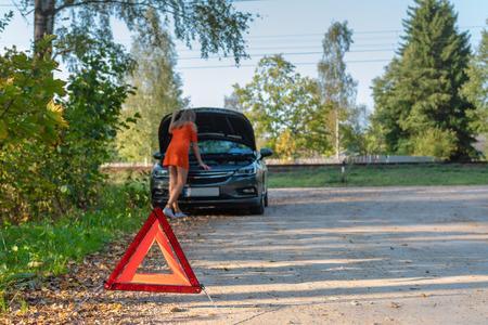 Car trouble, Women are stressed with broken car, about broken car. (selective focus) Reklamní fotografie
