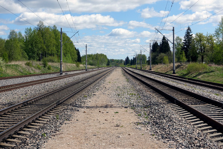 railway track with a background of clouds - Image