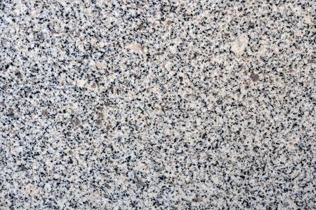Close up of a gray granite wal tevture - image