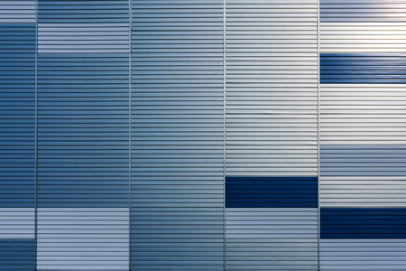 Abstract architectural background from modern buildings facade with blue and silver lines - image
