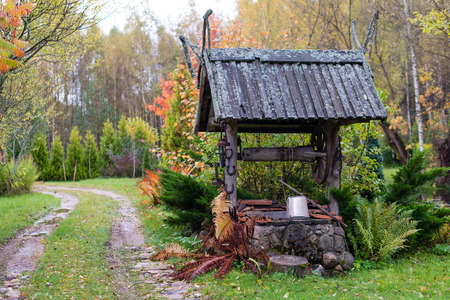Historic well with a wooden roof farmhouse yard.