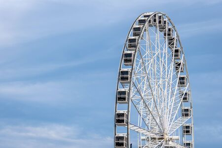 Panoramic wheel on a light blue sky background Stock Photo