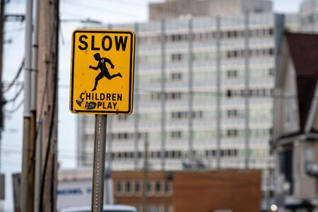 slow children caution sign on a street Stock Photo