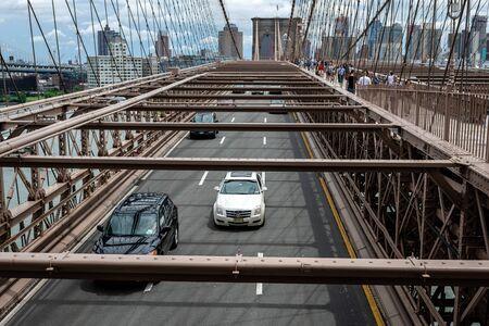 New York, USA - June 21, 2019: Road traffic over Brooklyn Bridge.