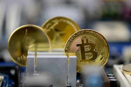 Golden Cryptocurrency coins on computer circuit board, selective focus - image Stock Photo