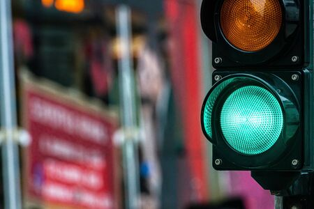 A city crossing with a semaphore. Green light in semaphore - image