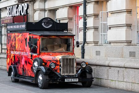 London, UK - January 1, 2020: Mobile colorful vintage food truck on the Queen's Walk, London, UK
