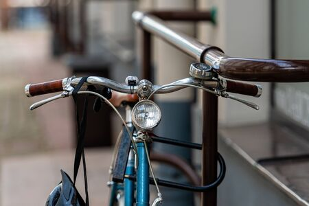 Close up of bicycle handlebars locked to a metal fence, security concept