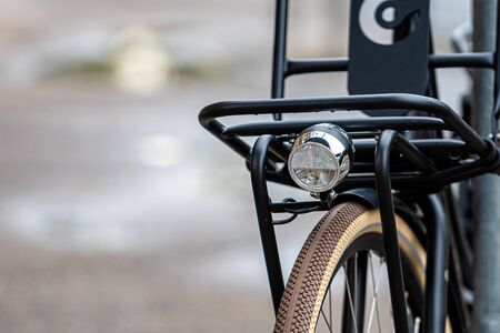 Close up of modern bicycle locked to a metal fence, security concept