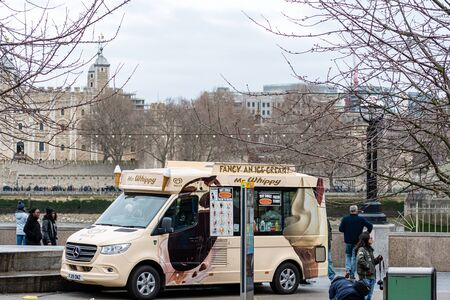 London, England, UK - January 3, 2020: Traditional food truck on the Southbank walkway on the Thames Promenade near Tower Bridge