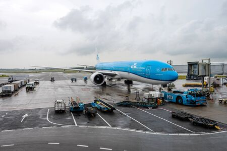 Amsterdam, Netherlands - June 5, 2019: KLM - Royal Dutch Airlines airplanes parked at the gate of Amsterdam Schiphol Airport with the KLM logo on airplane tales