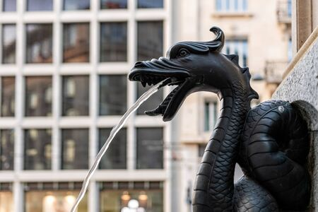 The fountain called Escalade, water spouts in the fountain through bronze dragon, close-up, Geneva, Switzerland - image Banque d'images
