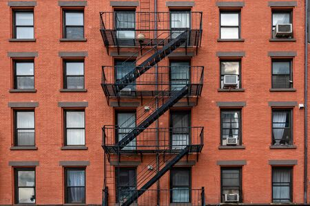 bricks buildings facades with fire escape stairs