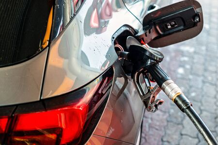 refueling car at the refuel station, rear view, car fuels concept Stock Photo