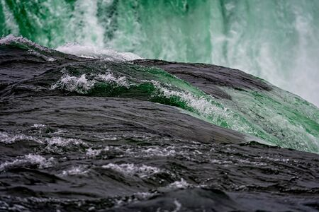 Niagara Falls splash close-up on a sunny day, lowing water background Standard-Bild