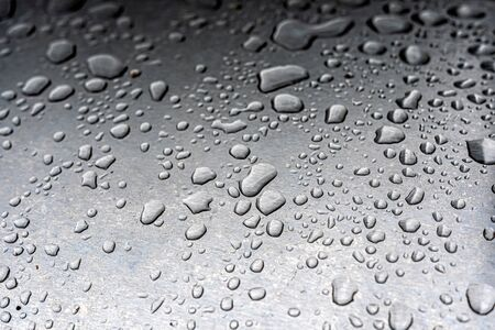 water Droplets on a metal Surface Stock Photo