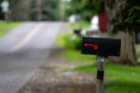 a traditional American mailbox on the side of a village road in Penfield, NY