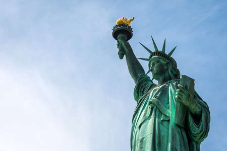 Statue of Liberty close up in a sunny day, blue sky in New York - Image