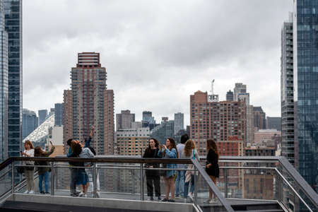 New York, USA - June 21, 2019: tourists from Wessel looking at Manhattan landscape with residential and office buildings near Hudson Yards