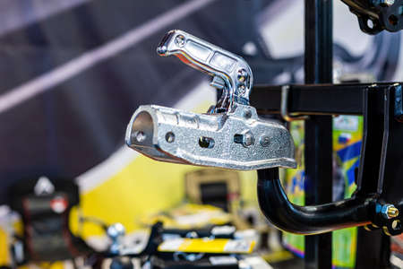 New and shiny trailer hitch or towbar at car accessories store - image