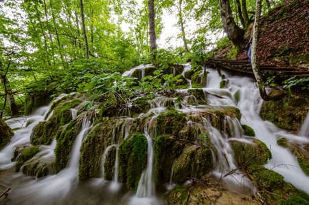 Stunning green waterfall in a forest at Plitvice Lakes National Park in Croatia