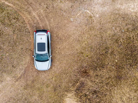 close-up of top view of a silver suv car standing in the field, copy space 版權商用圖片