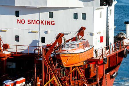 cargo vessel emergency safety rescue boat on deck Foto de archivo