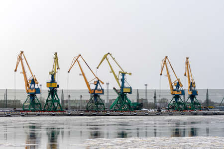 portal cranes on the berth for bulk cargo of the commercial port of Riga