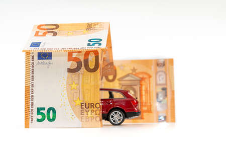 House from euro banknotes and car isolated on white. loan, real estate and car insurance concept Stockfoto