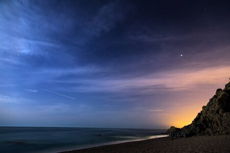 path to romance: Night sky with moonlight clouds over the coastline
