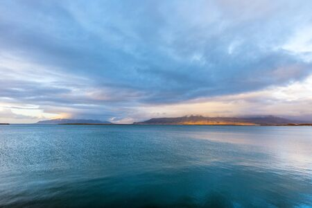 Embankment of Reykjavik with mountains and blue ocean. Iceland.