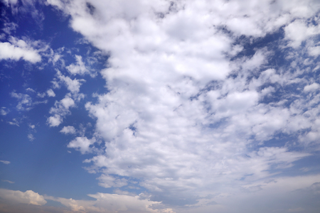 Background with blue sky and white clouds. Wallpaper