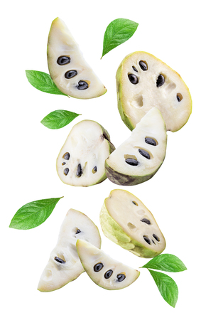Flying cherimoyas (sugar apple) isolated on white background with shadow. Clipping path. Stockfoto