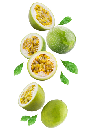 Flying passion fruits isolated on white background. Clipping path Archivio Fotografico