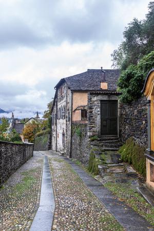 Old Italian courtyard in San Giulio. Italy