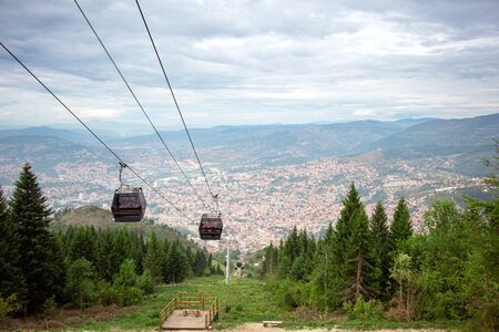 View from the top of the mountain on the city of Sarajevo and funicular. Eastern Europe