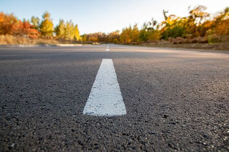 Empty gray road and the white traffic lines  Stock Photo
