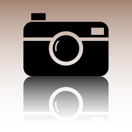 Digital photo camera icon. Black vector illustration with reflection.
