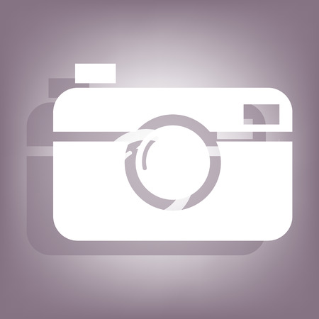 Digital photo camera icon with shadow on perple background. Flat style.