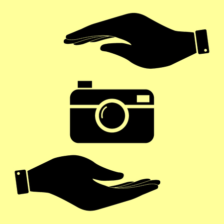 whim: Digital photo camera icon. Save or protect symbol by hands. Illustration