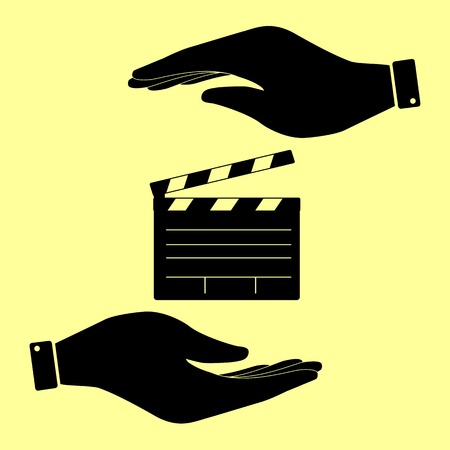 clap board: Film clap board cinema sign. Save or protect symbol by hands.