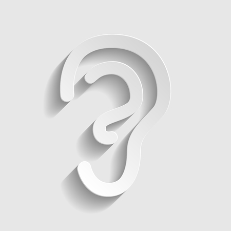 audible: Human ear sign. Paper style icon with shadow on gray.