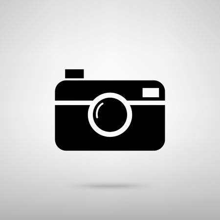 whim of fashion: Digital photo camera icon. Black with shadow on gray.