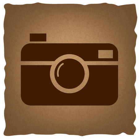 whim of fashion: Digital photo camera icon. Coffee style on old paper.