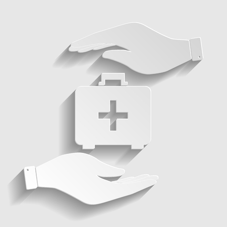 First aid box sign. Save or protect symbol by hands. Paper style icon with shadow on gray.